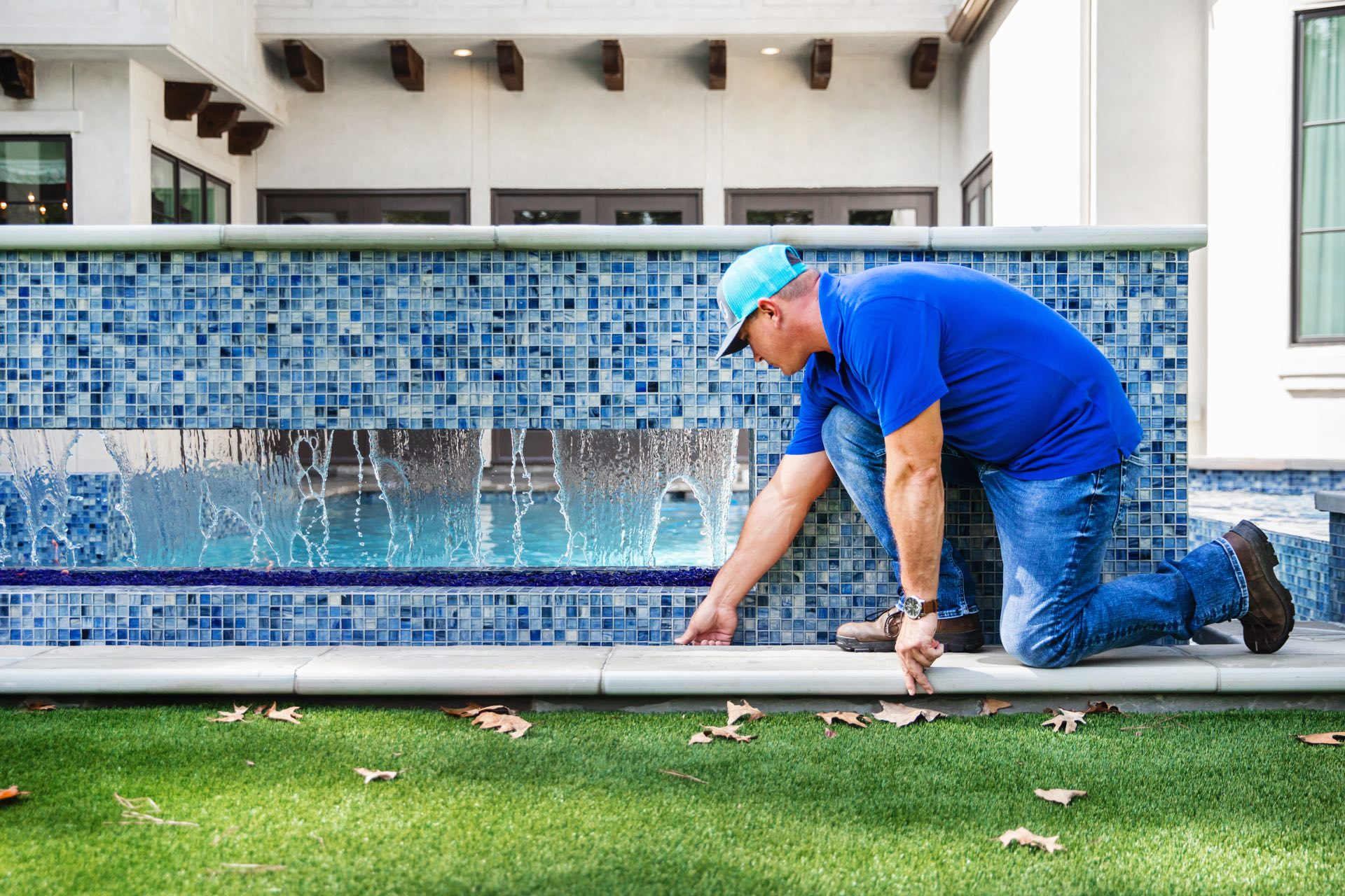Avea Pools maintenance person working on a client's custom swimming pool