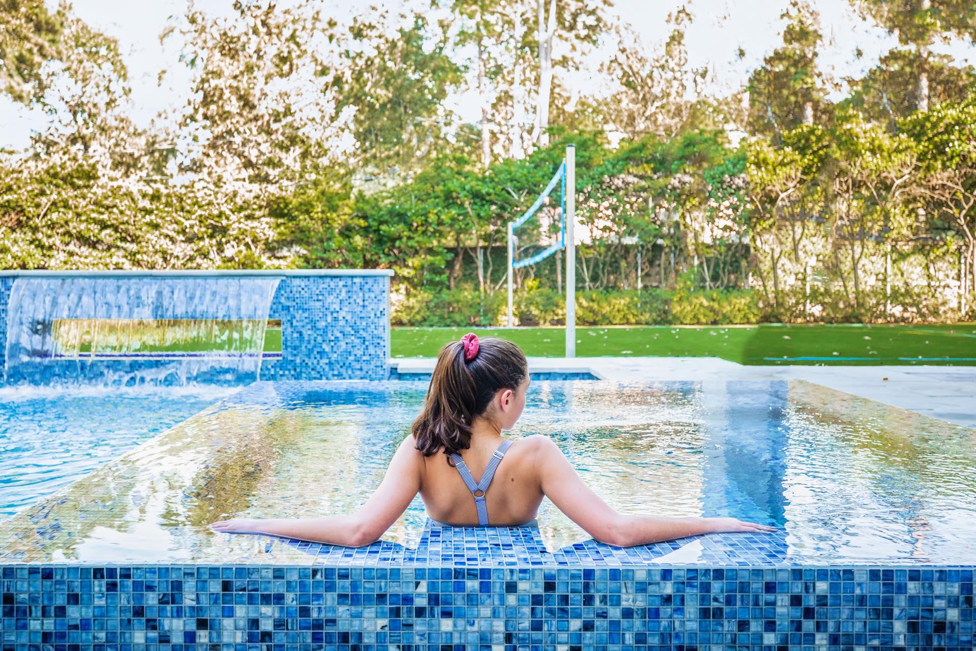 A girl relaxes in an Avea pool.