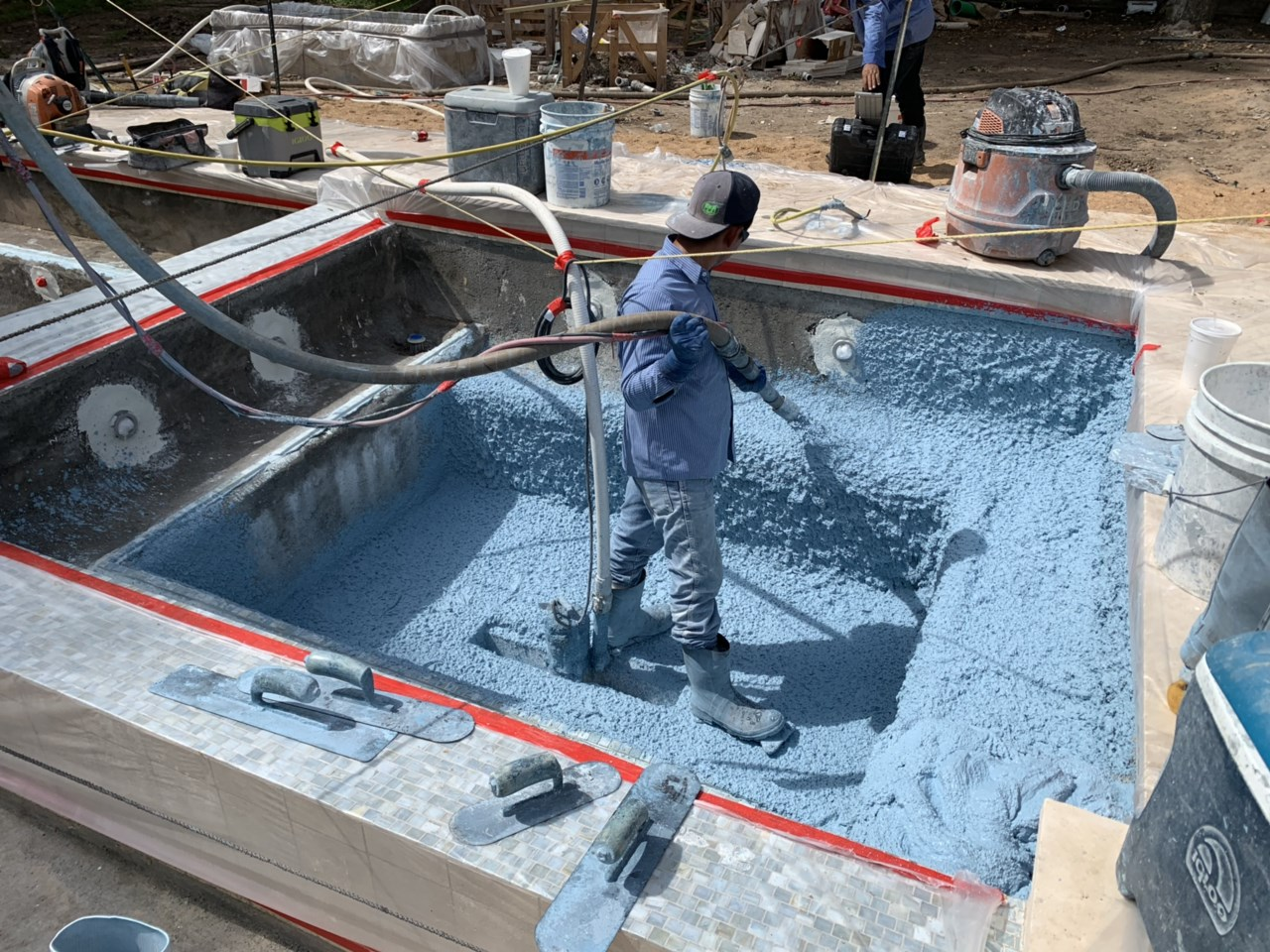 Workers filling in a custom pool by AVEA